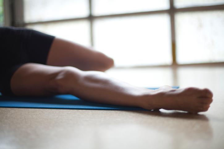 woman stretching legs