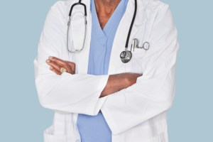 doctor with arms folded around chest