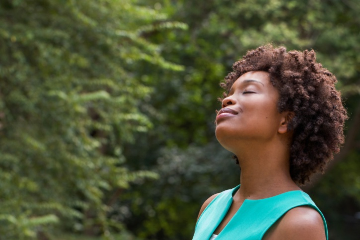 happy African American woman outside