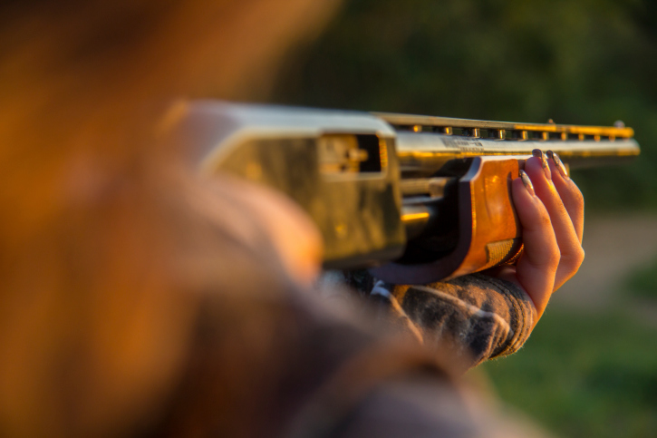 Closeup of Woman Aiming Shotgun