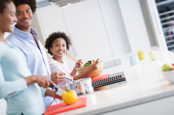 African American Black family in kitchen meal prepping