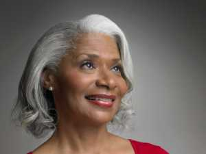 Older African American Black woman with gray hair smiling