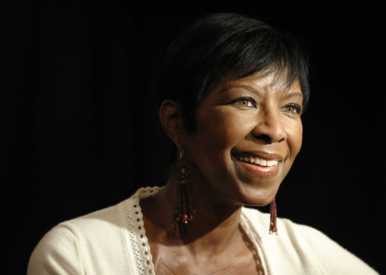 """Singer Natalie Cole looks on from the stage before signing copies of her new CD, """"Still Unforgettable,"""" at Borders Westwood in Los Angeles., Tuesday, Oct. 28, 2008. (AP Photo/Chris Pizzello)"""
