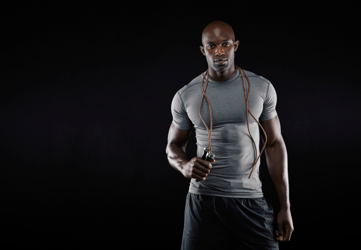 muscular African American man with jump rope