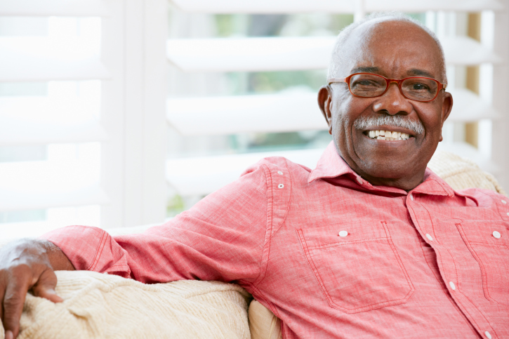 African American senior man smiling wearing glasses