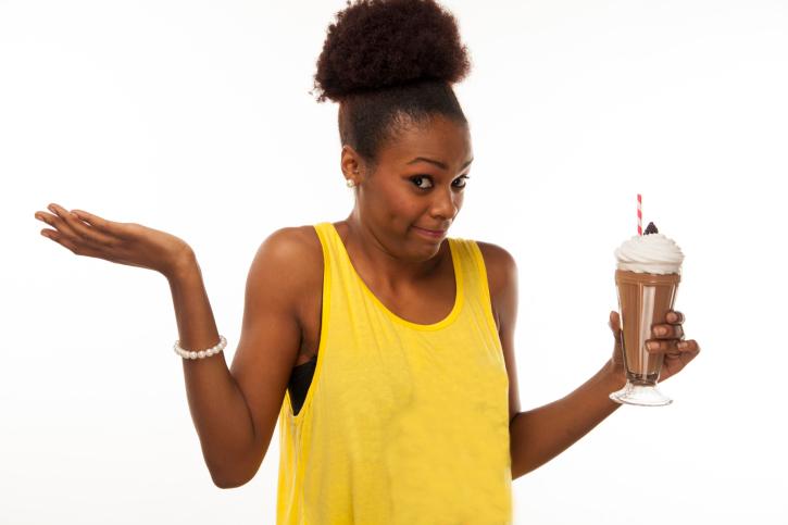 African American Black woman deciding if she wants milkshake