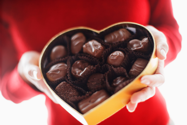Woman holding box of chocolates