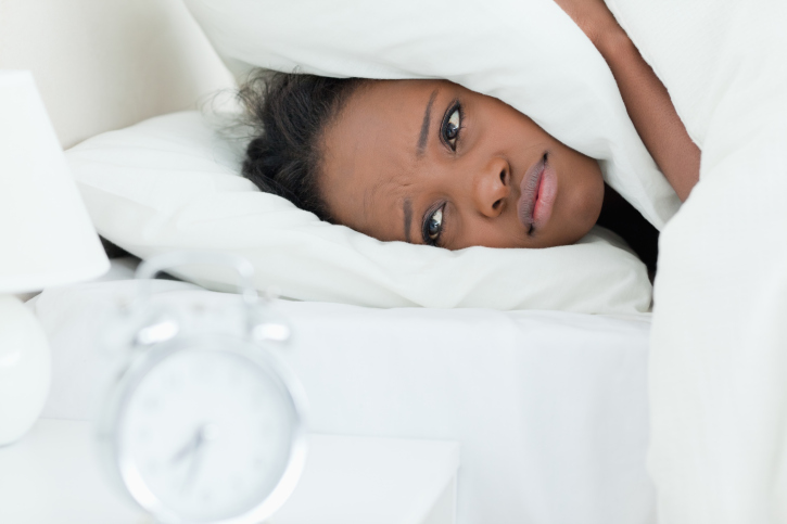 African American woman in bed