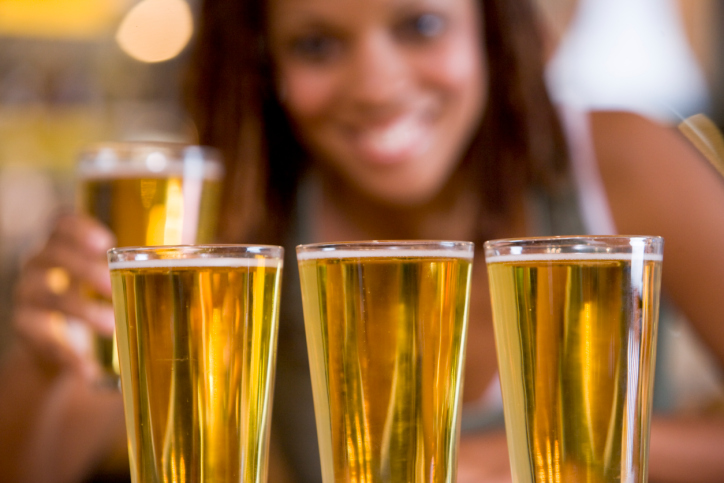 African American woman with glasses of beer