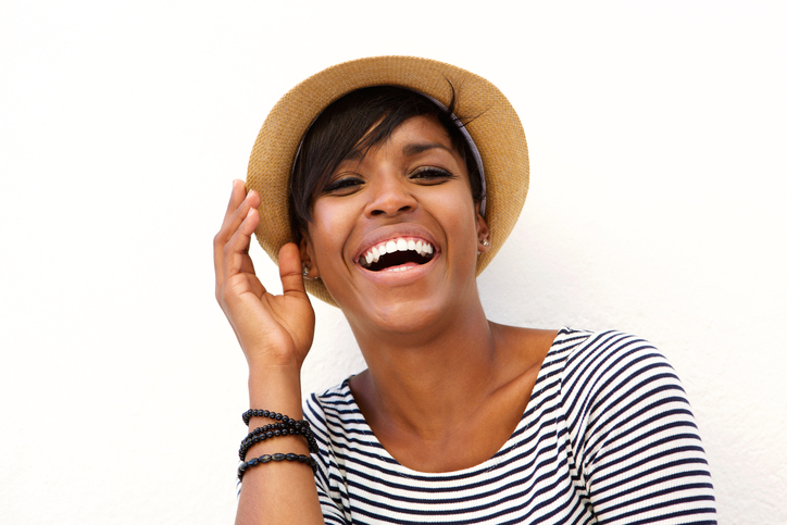 Happy African American woman wearing hat