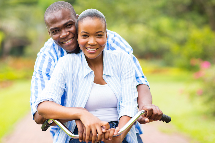 African American couple riding a bike