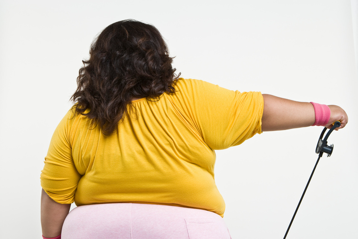 Overweight woman back fat exercising