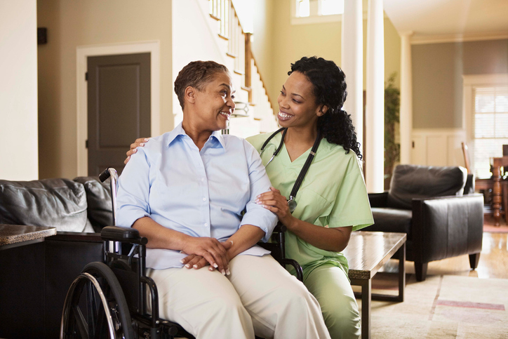 African American woman in wheelchair with nurse