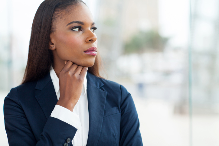 African American businesswoman looking thoughtful