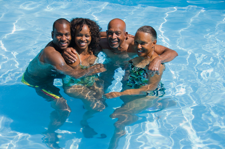 African American family in swimming pool