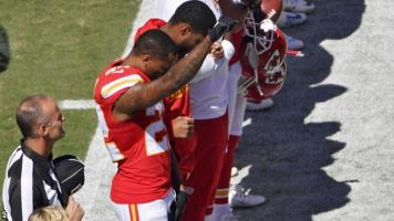 Marcus Peters of Kansas City Chiefs raises his fist in protest. Source: Twitter user @ShaunKing