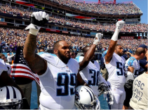 Jurrell Casey, Jason McCourty and Wesley Woodyard raise their fists. Source: Twitter User @ShaunKing