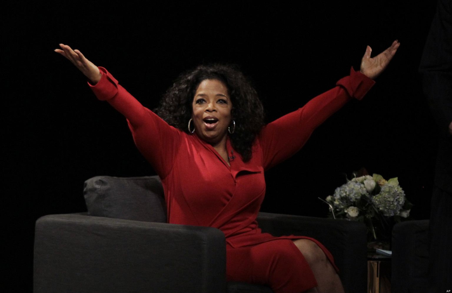"Oprah Winfrey acknowledges the audience after she came to the stage for an interview with Ball  State University alumnus David Letterman, host of CBS's ""Late Show,"" at Ball State University in Muncie, Ind., Monday, Nov. 26, 2012. The conversation is part of the David Letterman Distinguished Professional Lecture and Workshop Series. (AP Photo/Michael Conroy)"