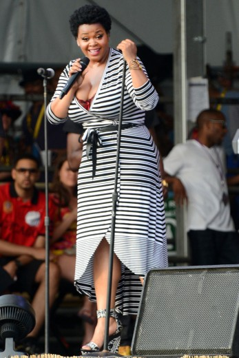 essencecom-jill-scott-performs-during-the-2013-new-orleans-jazz-heritage-music-festival-at-fair-grounds-race-course-in-new-orleans-louisiana_347x520_11
