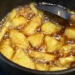 Pineapples boiling in brown sugar.