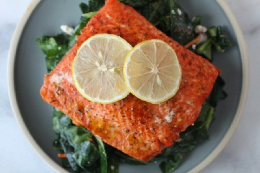 Air Fryer Salmon with Salad and Two Lemon Slices
