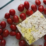 Block of Feta Cheese surrounded by tomatoes