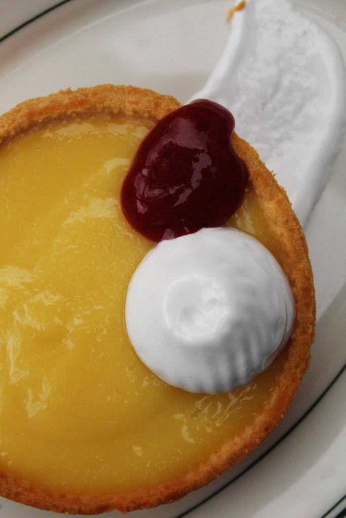 Key lime tart on white plate