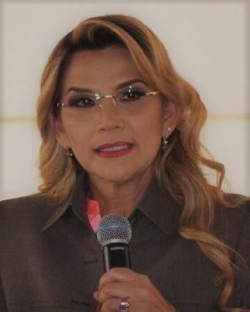 Jeanine Áñez holding mic