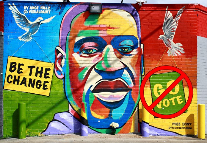 Mural of George Floyd which says Be The Change Go Vote, but the Go Vote has been crossed out