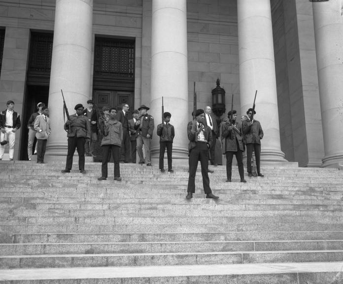 Black Panthers armed in solidarity at Government Building