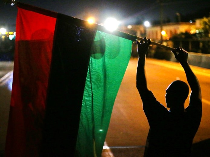 The Pan African flag, representing the people of Africa, the bloodshed brought upon by colonizers, and the rich fertility of African land.