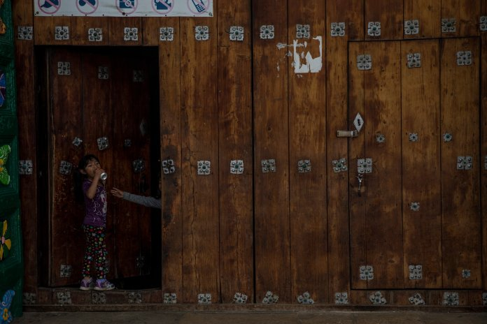 A mexican girl in Chiapas, Mexico, drinks a can of soda