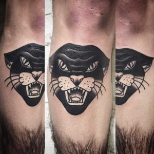 Panther 2 Blackwork Tattoo Vienna Wien Tattoostudio Oldschool traditional Tattoo Panther Gesicht face schwarz tatoo