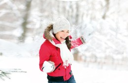 Woman with red coat in snow