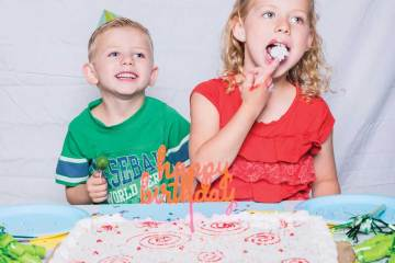 Kids destroying cake