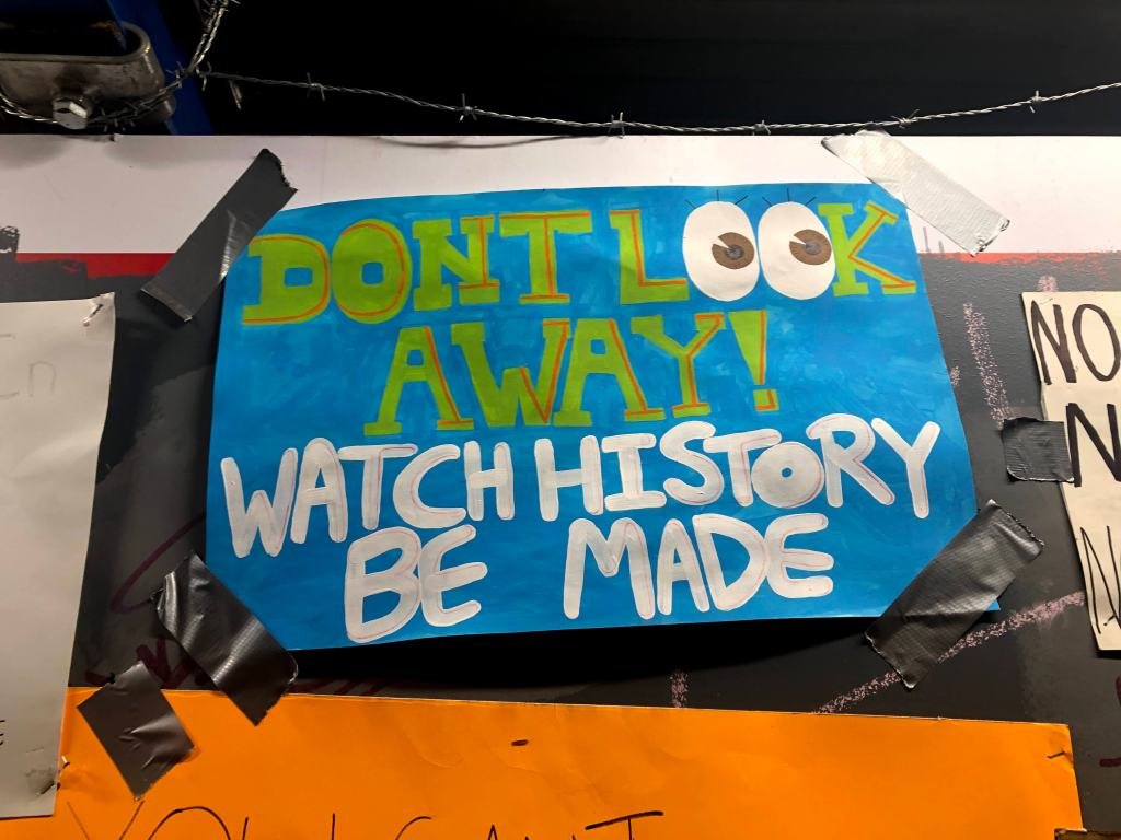 """Protest poster: """"DON'T LOOK AWAY! WATCH HISTORY BE MADE"""""""