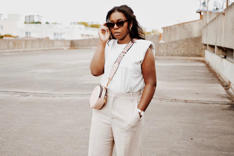 image feature black woman wearing a designer bag