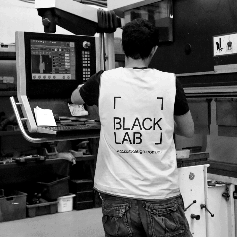black and white image of man programming machine