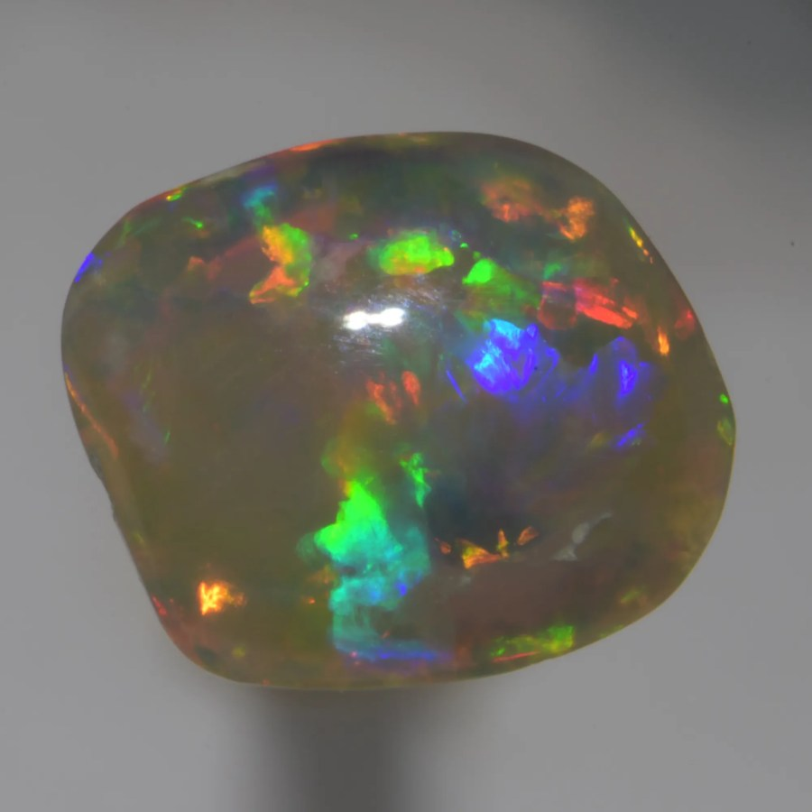 3.55 CT Natural Australian Solid Crystal Opal c200 Lightning Ridge Australia ready to be set on opal jewellery.this opal is direct from miners with no treatment and at wholesale price. best looking Crystal Opal with lots of red.