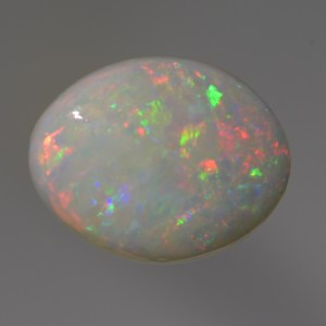 Nice red, green and blue, This natural light Opal would be perfect for an affordable ring.