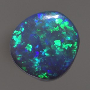 Brillant Natural Black Opal with green and blue would be perfect for a gold or silver ring.