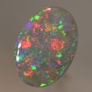 Sparkling Dark Opal with Flashing red and green in a beautiful floral pattern. This Opal has a perfect oval shape and would be ideal for alarge ring or small pendant.