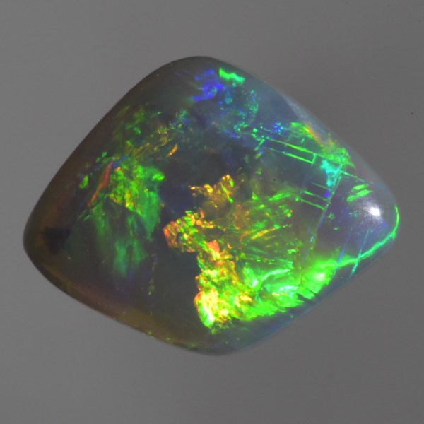 This Broad Flash pattern Dark Opal has brillant flashing gold, green, and blue colours and would look very nice set in a ring or pendant.