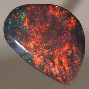 This Beautiful One of a kind Australian Black Opal found recently in Lightning Ridge ( 2019 ) has Fiery Reds mixed with a picture broad flash pattern. Cut and polished just weeks ago, this opal has never been on the market before now.