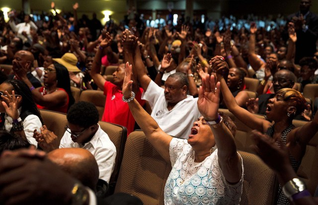 Hundreds of people gathered in the church to say goodbye to Michael Brown. (Richard Perry/The New York Times)