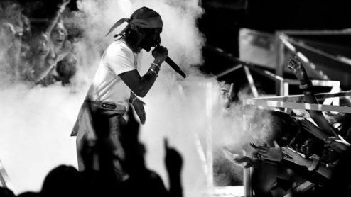 INGLEWOOD, CA - AUGUST 27:  (EDITORS NOTE: Image has been converted to black and white.)  Kendrick Lamar performs onstage during the 2017 MTV Video Music Awards at The Forum on August 27, 2017 in Inglewood, California.  (Photo by Kevin Winter/Getty Images)