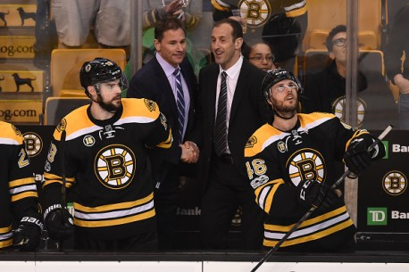 BOSTON, MA - APRIL 4: Head Coach Bruce Cassidy and Assistant Coach Jay Pandolfo of the Boston Bruins shake hands after clinching a play off spot against the Tampa Bay Lightning at the TD Garden on April 4, 2017 in Boston, Massachusetts. (Photo by Steve Babineau/NHLI via Getty Images)