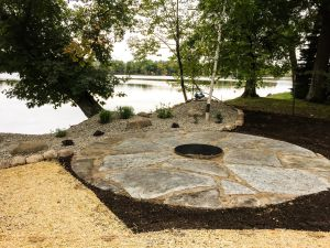 natural stone rock patio with firepit