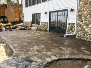 custom paver patio with drain tile