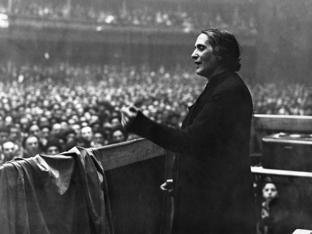 Photo of Dolores Ibárruri aka 'La Pasionaria' giving a speech.
